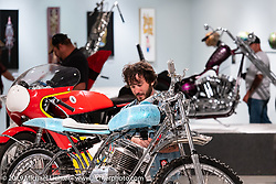 Checking out Utopeia Moto Company's Chris Tope's Ice Pick 1973 Wassell Mudlark ice racer in the What's the Skinny Exhibition (2019 iteration of the Motorcycles as Art annual series) at the Sturgis Buffalo Chip during the Sturgis Black Hills Motorcycle Rally. SD, USA. Thursday, August 8, 2019. Photography ©2019 Michael Lichter.