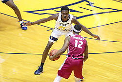 Nov 28, 2018; Morgantown, WV, USA; West Virginia Mountaineers forward Wesley Harris (21) defends Rider Broncs guard Anthony Durham (12) during the first half at WVU Coliseum. Mandatory Credit: Ben Queen-USA TODAY Sports