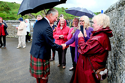 The Prince of Wales, known as the Duke of Rothesay while in Scotland, shakes hands with Marion Robertson during a visit to Sail Loft Bunkhouse, Portsoy where he willl met members of the restoration team who have converted 18th century sailmakers' cottages into the 25-bed Sail Loft Bunkhouse.