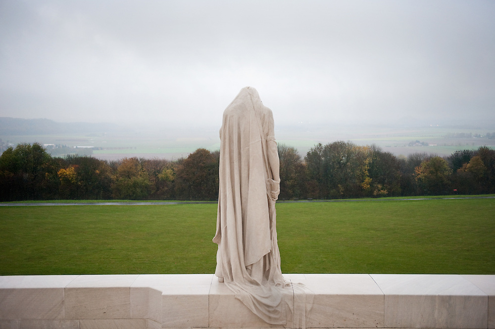 """The weeping woman or better known as """"Mother Canada mourning her dead"""" overlooks the Douai Plains at the Canadian National Vimy Memorial dedicated to the memory of Canadian Expeditionary Force members killed in World War one. The monument is situated at a 100 hectare preserved battlefield with wartime tunnels, trenches, craters and unexploded munitions. The memorial designed by Walter Seymour Allward opened in 1936."""