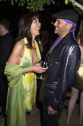 Phillip Bloch and Maria Conchita Alonso. Talk pre-Golden Globes party. Mondrian Hotel. West Hollywood, California USA 20 January 2001. © Copyright Photograph by Dafydd Jones 66 Stockwell Park Rd. London SW9 0DA Tel 020 7733 0108 www.dafjones.com