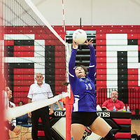 Matejka Abeita sets the ball for the Miyamura Lady Patriots in their match against the Grants Lady Pirates Tuesday, Sept. 25, 2018 at Grants High School.