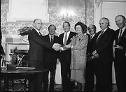 New Fianna Fáil Administration Sworn In.  (R52)..1987..10.03.1987..03.10.1987..10th March 1987..After their win in the recent general election the new Fianna Fáil government,under the leadershio of Charles Haughey, was sworn in and given their seals of offce at a ceremony in Áras an Uachtaráin today. The government received their seals from President Patrick Hillery...Photograph shows President Hillery presenting the seal of office to Mary O'Rourke at the ceremony in the Arás