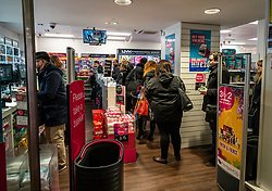 © Licensed to London News Pictures. 16/03/2020. London, UK. Commuters queue at a chemist this morning in Westminster as Government ministers warn that over 70s will face set-isolation for weeks as the Coronavirus disease pandemic continues . Photo credit: Alex Lentati/LNP