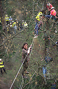 Walkways and treehouses. Road Protest actions around the M65 extension. This involved protecting and squatting a group of houses, and also squatting treehouses in the forest at  Stanworth Valley Preston Lancashire. 1995<br /><br />The British Road Protesters movement began in the early 1990s when the Donga tribe squatted Twyford Down to save this beautiful site, a site of scientific interest SSI from the Ministry of transport's road building programme which threatened to destroy the landscape. The Dongas was the name of the ancient walkways, the paths trodden in the middle ages by people walking down to Winchester. A small tribe were joined by people of all walks of life who came to Twyford Down to defend it. A long hard battle over several years ended in the 'cutting' a new motorway built through this ancient monument and destroying it. <br /><br />The Road Protest movement in Britain continued for many years and more battles were fought in London against the MII both at Wanstead then in Leytonstone, and subsequently at Newbury, and in Sussex. the protesters were very inventive in their use of non violent peaceful direct action. They barricaded themselves into squats, made tree houses, tunnels and have huge demonstrations against the bailliffs, police and security who tried to force their way through the defences of this alternative environmental popular movement. Many of the roads were built eventually and many sites of great beauty lost, but the government had to stand down from its road building policy and eventually the programme was halted. the protests cost the government billions. Out of that movement grew many environmental NGOs who have to this day kept fighting for ecological and sustainable environmental solutions rather than following the cult of the car, petrol and roadbuilding..