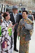 Royal Ascot racegoers From Japan,  at Waterloo station. London. 19 June 2013.