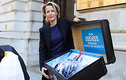 October 9, 2018 - London, UK - Gillian Anderson with a sculpture of a penguin outside the Foreign & Commonwealth Office in London before delivering a 350,000-strong petition calling on the government to protect the Antarctic. (Credit Image: © Gustavo Valiente/i-Images via ZUMA Press)