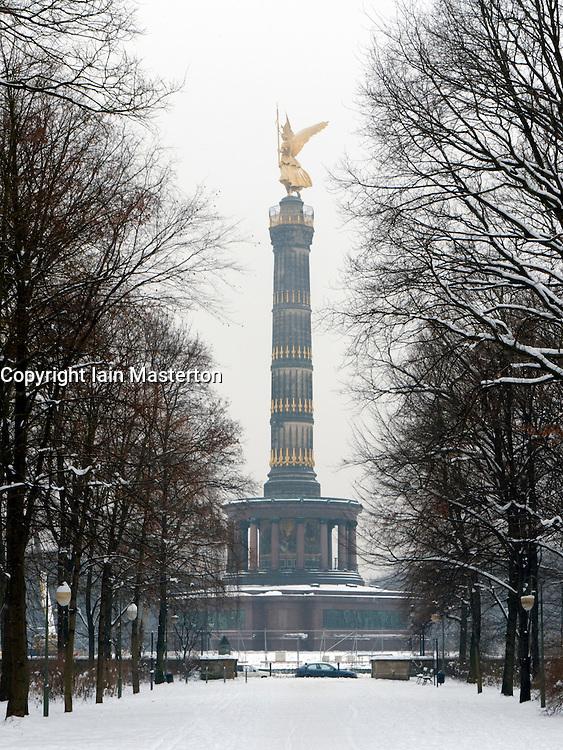 Snow covered parkland and Siegessäule in Tiergarten Park in central Berlin in winter 2010