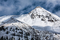 First snow of the autumn season on 13,114 ft. Telluride Peak, as viewed from Red Mountain Pass.  San Juan Mountains, Colorado.