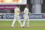 Lewis Gregory of Somerset and Steve Davies of Somerset leave the field as rain stops play during the Specsavers County Champ Div 1 match between Somerset County Cricket Club and Essex County Cricket Club at the Cooper Associates County Ground, Taunton, United Kingdom on 26 September 2019.