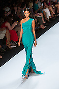 Sea green one-shoulder gown with a slit side. By Monique Lhuillier at Spring 2013 Fall Fashion Week in New York.