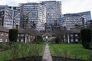 Hoptons Almshouses on Hopton Street, Southwark on 28th January 2021 in London, United Kingdom. Tall glass buildings loom behind these historically important houses at Bankside and near to Tate Modern. Founded by Robert Hopton, fishmonger in 1730. Properties built around a garden in 1752 and are still in use. Before the days of state provision for the old, infirm or poor it was common for wealthy individuals to bequeath money or property to the local parish or to set up independent institutions to assist those in need locally.Many ancient parishes have such institutions and many almshouses still survive. However it is unusual to find one founded as early as 1752 still in its original form, carrying out its original function, so close to London.Hoptons Almshouses were founded from a trust set up by the will of Charles Hopton.
