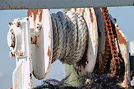 """Tools of the Trade<br /> Closeup of spooled rope and winding gears and wonderful """"rustification"""" of a fishing boat on Chincoteague Island, Maryland. Chincoteague is a combination fishing town, vacation homes, businesses and wildlife preserve."""