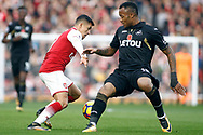 Alexis Sanchez of Arsenal (L) fends off Jordan Ayew of Swansea City (R). Premier league match, Arsenal v Swansea city at the Emirates Stadium in London on Saturday 28th October 2017.<br /> pic by Steffan Bowen, Andrew Orchard sports photography.