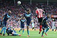 Sunderland defender Papy Djilobodji (5)  with a header toward goal during the Premier League match between Sunderland and Middlesbrough at the Stadium Of Light, Sunderland, England on 21 August 2016. Photo by Simon Davies.
