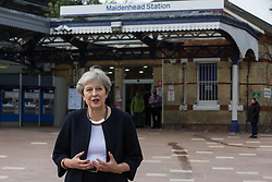 Maidenhead, UK. 11th October, 2021. Theresa May, Conservative MP for Maidenhead, speaks on the occasion of the official opening of a new Maidenhead station forecourt. The £3.75m refurbishment is intended to make the area around the station more commuter-friendly in anticipation of an increase in passengers when Crossrail opens and to improve both the interchange between trains and other forms of transport and walking and cycling links between the station and the town centre.