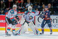 KELOWNA, CANADA - DECEMBER 27: Jackson Shepard #9 of the Kamloops Blazers looks for pass as Cal Foote #25 and Michael Herringer #30 of the Kelowna Rockets defend the net on December 27, 2016 at Prospera Place in Kelowna, British Columbia, Canada.  (Photo by Marissa Baecker/Shoot the Breeze)  *** Local Caption ***