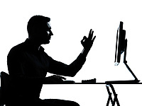 one caucasian business man computer computing ok gesture silhouette in studio isolated on white background