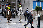 Two Women Officers with the City of London Police, ride their horses on a routine daily patrol through the City of London, the capital's financial district, on 22nd June 2021, in London, England.