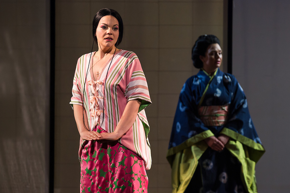 """LONDON, UK, 14 May, 2016. Rina Harms (left, as Butterfly) and Stephanie Windsor-Lewis (as Suzuki) rehearse for the revival of director Anthony Minghella's production of Puccini's opera """"Madam Butterfly"""" at the London Coliseum for the English National Opera. The production opens on 16 May. Photo credit: Scott Rylander."""