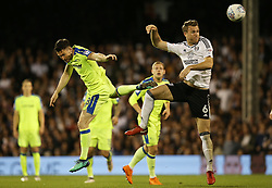 Kevin McDonald of Fulham and David Nugent of Derby County challenge for the ball - Mandatory by-line: Paul Terry/JMP - 14/05/2018 - FOOTBALL - Craven Cottage - Fulham, England - Fulham v Derby County - Sky Bet Championship Play-off Semi-Final