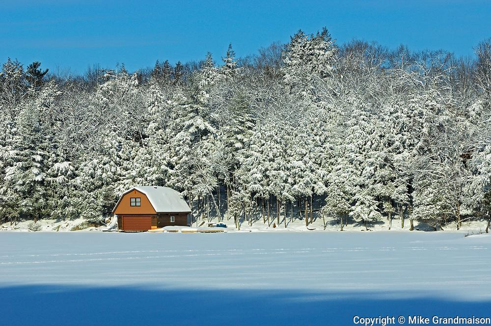 Boathouse onLake Rosseau in winter, Muskoka Country, Ontario, Canada