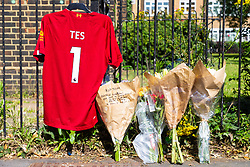 Floral tributes and a Liverpool FC shirt Emblazoned with TEShave been placed at the scene where a man in his 40s was stabbed on Latchmere Road in Battersea in the afternoon of July 3rd 2019, dying later that evening in hospital.. London, July 04 2019.