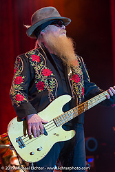 Dusty Hill on stage as ZZ Top headlines at  Cycle Fest at Westworld during Arizona Bike Week. April 5, 2014.  Photography ©2014 Michael Lichter.