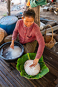 A woman packages rice noodles. Angkor Wat, Siem Reap, Cambodia.