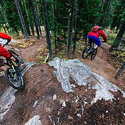 Harlan Hottenstein and Andrew Whiteford descend the Lithium single track off of Teton Pass near Wilson, Wyoming.