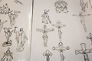 Il catalogo di tatuaggi possibili esposto sul bancone del piccolo bnegozio nella citta' vecchia di Gerusalemme