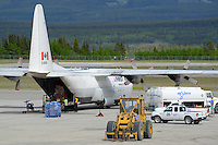 A First Air C-130 Hercules unloads at Whitehorse International Airport.