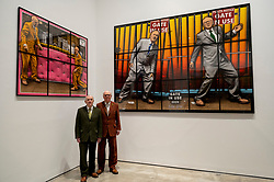 "© Licensed to London News Pictures. 12/04/2021. LONDON, UK.  Gilbert & George pose in front of ""Gate In Use"", 2020, at their ""NEW NORMAL PICTURES"" exhibition at White Cube's Mason's Yard gallery in Mayfair. The exhibition displays 26 pictures from a new series the pair have been working on for over two years.  The UK government's coronavirus roadmap out of lockdown has allowed art galleries to reopen today. The exhibition runs 13 April to 8 May 2021.  Photo credit: Stephen Chung/LNP"
