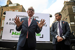 © Licensed to London News Pictures. 07/11/2019. London, UK. Former Labour MPs IAN AUSTIN and JOHN WOODCOCK speaking at a press conference in Westminster, London following an interview in which IAN AUSTIN called for people to vote for the Conservative party in order to keep Jeremy Corbyn out of Downing Street. A general election has been called on December 12th in an attempt to get a Brexit agreement through parliament. Photo credit: Ben Cawthra/LNP