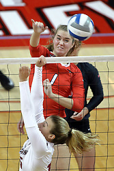 17 October 2015:  Ali Line(1) strikes the ball past Abby Barrow during an NCAA women's volleyball match between the Southern Illinois Salukis and the Illinois State Redbirds at Redbird Arena in Normal IL (Photo by Alan Look)