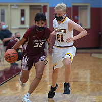 Shiprock Chieftain Shannon Dale (32) drives the ball down the court as Rehoboth Lynx Isaac Zwiers (21) defends Tuesday at Rehoboth Christian School in Rehoboth.