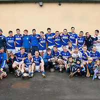The Victorious Cratloe Hurling team with the Senior Club Hurling and the Clare Cup, both of which they have won this year