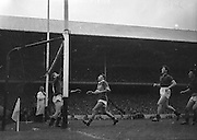 John Dowling Kerry full forward watches as his ball sails over the bar for a point during the All Ireland Senior Gaelic Football Final Kerry v Down in Croke Park on the 22nd September 1960. Down 2-10 Kerry 0-8.