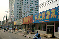 China, Beijing, Chaoyang, San Jian Fang, 2008. Stripped of their insides, the corner businesses across the street from the back gate of Beijing International Studies University await demolition. See image 34 in this series.