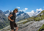 """Hike from Pontresina up Roseg Valley to Fuorcla Surlej for stunning views of Piz Bernina and Piz Rosegg, finishing at Corvatsch Mittelstation Murtel lift. Walking 14 km, we went up 1100 meters and down 150 m. Optionally shorten the hike to an easy 4 km via round trip lift. Pontresina is in Upper Engadine, in Graubünden (Grisons) canton, Switzerland, the Alps, Europe. The Swiss valley of Engadine translates as the """"garden of the En (or Inn) River"""" (Engadin in German, Engiadina in Romansh, Engadina in Italian). For licensing options, please inquire."""