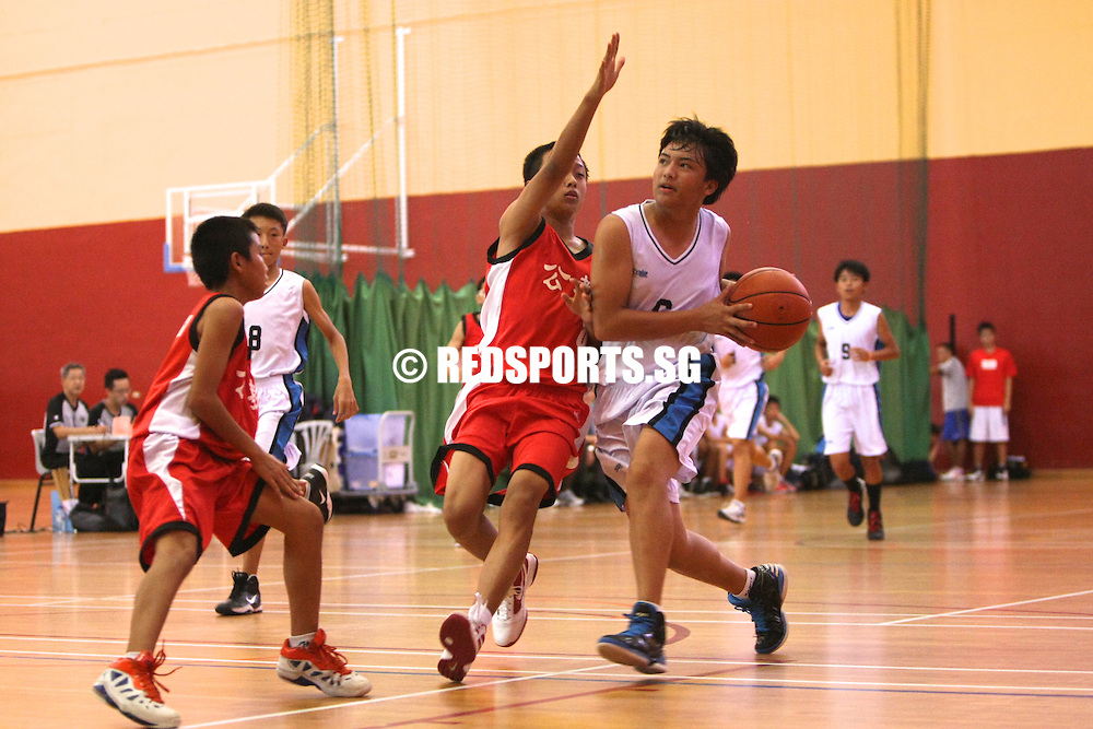 PESEB, Evans Road, Wednesday, July 31, 2013 — Catholic High secured safe passage into the semi-finals of the South Zone C Boys Basketball Championship with a comfortable 16–62 win over St. Andrews' Secondary (SAS), effectively eliminating their opponents.<br /> <br /> Story: http://www.redsports.sg/2013/08/01/south-zone-c-div-bball-saints-catholic-high/