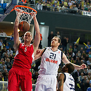 Fenerbahce Ulker's Oguz SAVAS (C) and Olympiacos's Rasho NESTEROVIC (L) during their Euroleague Basketball Top 16 Game 5 match Fenerbahce Ulker between Olympiacos at Sinan Erdem Arena in Istanbul, Turkey, Thursday, February 24, 2011. Photo by TURKPIX