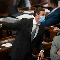 Austin, TX USA March 31, 2021:  State Rep. Trent Ashby, R-Lufkin, on the floor of the Texas House of Representatives during routine bill readings at the 87th Texas legislative session. Emergency bills include power company regulation, border security and the coronavirus response.