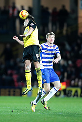 Watford's Gabriele Angella heads the ball away from Reading's Pavel Pogrebnyak - Photo mandatory by-line: Nigel Pitts-Drake/JMP - Tel: Mobile: 07966 386802 11/01/2014 - SPORT - FOOTBALL - Vicarage Road - Watford - Watford v Reading - Sky Bet Championship