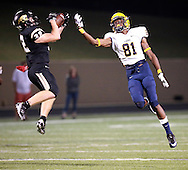 The Lions' wide receiver Troydell Griffin watches as Marcus Russell intercepts a pass during a game against Plano East Senior High on Friday, Oct. 14, 2016 at Tom Kimbrough Stadium in Plano. Plano East won 60-35. (Photo by Kevin Bartram/buzzzphotos.com)