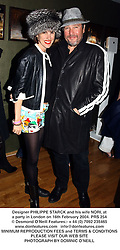 PHILIPPE STARCK and his wife NORI at a party hosted by Fendi in association with Wallpaper magazine to celebrate the Compilation Bag and the March Fashion Issue held at Fendi, 20-22 Sloane Street, London followed by a late night party at MJU Restaurant, 17 Sloane Street, London SW1 on 16th February 2004.