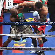 LAS VEGAS, NV - SEPTEMBER 13: Floyd Mayweather Jr. (L) and Marcos Maidana trade blows during their WBC/WBA welterweight title fight at the MGM Grand Garden Arena on September 13, 2014 in Las Vegas, Nevada. (Photo by Alex Menendez/Getty Images) *** Local Caption *** Floyd Mayweather Jr; Marcos Maidana