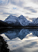 Alaska, Chugach State Park, Eklutna Lake.  Reflection of the Mitre with dusting of snow.