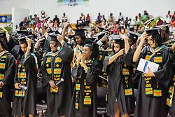 Graduates turn their tassels.  Fifty-first annual University of the Virgin Islands  Commencement Exercises.  UVI Sports & Fitness Center.  St. Thomas, VI.  14 May 2015.  © Aisha-Zakiya Boyd