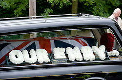 © licensed to London News Pictures. 18/05/2011. Oxted, UK. The funeral cortege of heavyweight boxing legend Sir Henry Cooper passes through Oxted, Surrey today (18/05/2011) after leaving the family home on its way to a private service in Tonbridge, Kent. Please see special instructions for usage rates. Photo credit should read Ben Cawthra/LNP